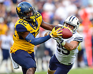 Landover, MD - SEPT 24, 2016: West Virginia Mountaineers tight end Elijah Wellman (28) almost pulls off a spectacular catch defended by BYU Cougars defensive back Cody Stewart (29) during their match up at FedEx Field in Landover, MD. (Photo by Phil Peters/Media Images International)