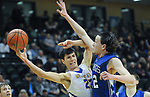 9263<br /> Metlakatla&rsquo;s Carsen Winter battles the defense of Petersburg&rsquo;s Wolf Brooks during the Chiefs&rsquo; 46-26 loss to Petersburg in the 2A state championship game Saturday, March 18, 2017.  Photo for the Daily News by Michael Dinneen