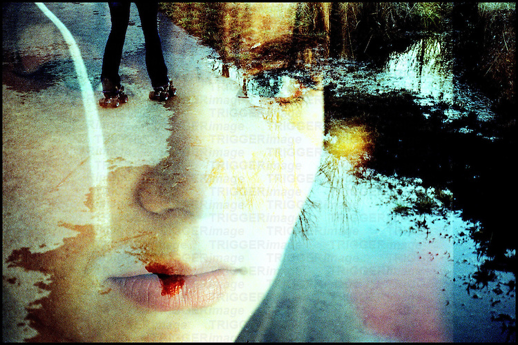 The face of a young woman superimposed on a water