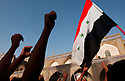 Iraqi Shia'as aligned with Shia cleric Moqtada al Sadr protest the detention and alleged mistreatment of 5 of their collegues last week by US Army troops during a July 21, 2003 protest at the Kadhimiya Shrine.