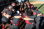 19 February 2017: Ohio State players huddle before the game. The Ohio State University Buckeyes played the University of Louisville Cardinals at Anderson Family Softball Stadium in Chapel Hill, North Carolina as part of the ACC/Big 10 College Softball Challenge. OSU won the game 4-3.