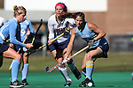 15 November 2014: North Carolina's Samantha Travers (ZIM) (right) and Emma Bozek (left) screen Liberty's Sarah Gipe (center) off of the ball. The University of North Carolina Tar Heels hosted the Liberty University Flames at Francis E. Henry Stadium in Chapel Hill, North Carolina in a 2014 NCAA Division I Field Hockey Tournament First Round game. UNC won the game 2-1.