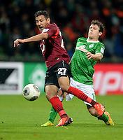 FUSSBALL   1. BUNDESLIGA   SAISON 2013/2014   11. SPIELTAG SV Werder Bremen - Hannover 96                         03.11.2013 Deniz Kadah (li, Hannover) gegen Zlatko Junuzovic (re, SV Werder Bremen)