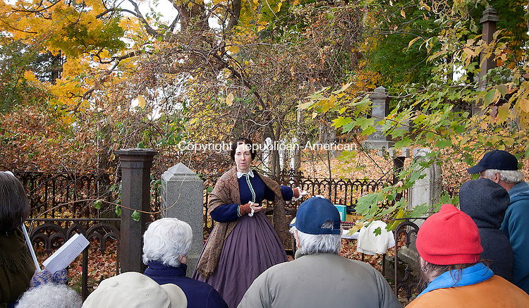 WINSTED, CT - 24 OCTOBER 2015 - 102415JW05.jpg -- Deb Kessler as Mrs. Normand Adams talks about her life helping her husband run their dry goods store to a crowd of onlookers Saturday afternoon during a historical tour of Winsted Old Burying Ground. Jonathan Wilcox Republican-American