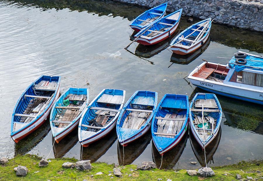 Boats in Amantani Island in Lake Titicaca in Peru.