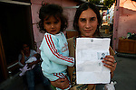 Roma Gypsies with Fingerprinted copies Police ID cards. The Police keep the originals. Naples, Italy