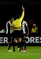 BOGOTA - COLOMBIA – 19 – 04 - 2017: Fernando Rapallini (Cent.) arbitro Argentino, muestra tarjeta amarilla a Bruno Henrique (Der.) jugador de Santos, durante partido entre Independiente Santa Fe de Colombia y Santos de Brasil, de la fase de grupos, grupo 2, fecha 3 por la Copa Conmebol Libertadores Bridgestone 2017, en el estadio Nemesio Camacho El Campin, de la ciudad de Bogota. / Fernando Rapallini (C), Argentinian, referee, shows yellow card to Bruno Henrique (R) player of Santo, during a match between Independiente Santa Fe of Colombia and Santos of Brasil, of the group stage, group 2 of the date 3, for the Conmebol Copa Libertadores Bridgestone 2017 at the Nemesio Camacho El Campin in Bogota city. VizzorImage / Luis Ramirez / Staff.