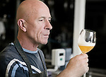 Brewmaster Tommy samples the latest brew to come out of the kegs. The small brewery in Raervig, Denmark is a new brewery on the competitive scene of micro brewers in Europe.