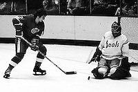 "Gary Simmons ""The Cobra"" blocks shot by Detroit Redwing #12 J.P.LeBlanc...(1976 photo/Ron Riesterer)"