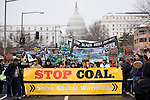Native Americans lead the march on the Coal Plant in Washington D.C. On March 2, 2009, thousands of protestors marched on the Capitol Coal Plant in Washington, D.C. The protestors were calling for clean renewable energy future. Two days before the planned protest, the US government announced that the plant would be converted to Natural Gas. Organizers cited this news as a partial, but incomplete victory - as Natural Gas is still a fossil fuel - and vowed to take on coal plants across the country.  (©Robert vanWaarden).