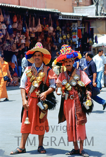 Water sellers in brightly coloured costumes in the Djemma El Fna square in Marrakesh, Morocco