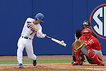 09 June 2012: Florida's Casey Turgeon (2) hits the ball in front of NC State catcher Brett Austin. The University of Florida Gators defeated the North Carolina State University Wolfpack 7-1 at Alfred A. McKethan Stadum in Gainesville, Florida in Game 1 of their NCAA College Baseball Super Regional series.