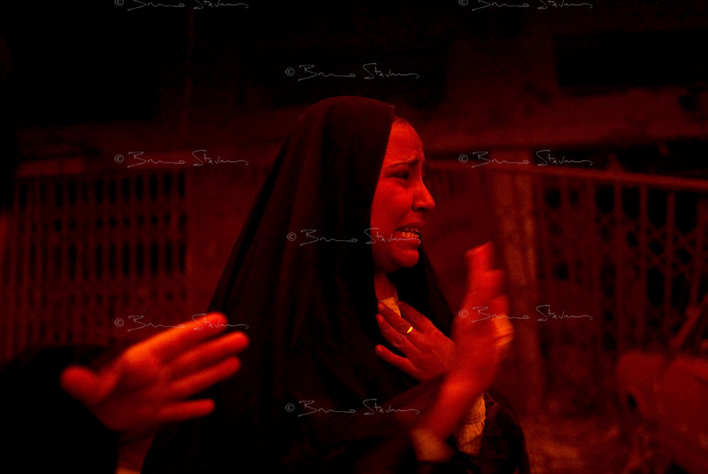 Baghdad, Iraq, March 26, 2003.A woman cries in despair after learning her brother was among the many civilian victims (around 20 according to witnesses) of two US bombs which fell without apparent reason in Cha'ab avenue, a busy street on the edge of Saddam City, one of the poorest neighbourhood in Baghdad.