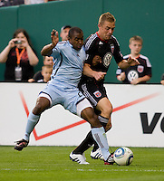 Danny Allsopp (9) of D.C. United is pushed off the ball by Marvell Wynne (22) of the Colorado Rapids at RFK Stadium in Washington, DC.  The Colorado Rapids defeated D.C. United, 1-0.