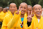 Young happy Shaolin Kung Fu students smiling for the camera in DengFeng, Zhengzhou, Henan, China