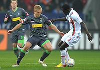 FUSSBALL   1. BUNDESLIGA  SAISON 2011/2012   16. Spieltag FC Augsburg - Borussia Moenchengladbach            10.12.2011 Mike Hanke (li, Borussia Moenchengladbach)  gegen Gibril Sankoh (FC Augsburg)