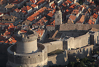 View over the rooftops of the medieval walled city with the Minceta Tower on the North ramparts, designed by Nicifor Ranjina in the 14th century, Dubrovnik, Croatia. The city developed as an important port in the 15th and 16th centuries and has had a multicultural history, allied to the Romans, Ostrogoths, Byzantines, Ancona, Hungary and the Ottomans. In 1979 the city was listed as a UNESCO World Heritage Site. Picture by Manuel Cohen