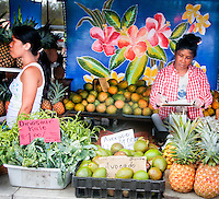 Local vendors at a farmers market in Hawaii selling locally produced fruits and vegetables