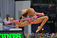 September 8, 2009; Mie, Japan;  Evgeniya Kanaeva of Russia performs stag leap with rope during qualification round at 2009 World Championships Mie. Evgeniya became world champion 3-days later at Mie and was the 2008 gold individual medalist in rhythmic gymnastics at the Beijing Olympics. Photo by Tom Theobald.