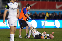Matt Garvey of Bath Rugby is treated for cramp by Head of Sports Medicine Declan Lynch. Aviva Premiership match, between Saracens and Bath Rugby on January 30, 2016 at Allianz Park in London, England. Photo by: Patrick Khachfe / Onside Images