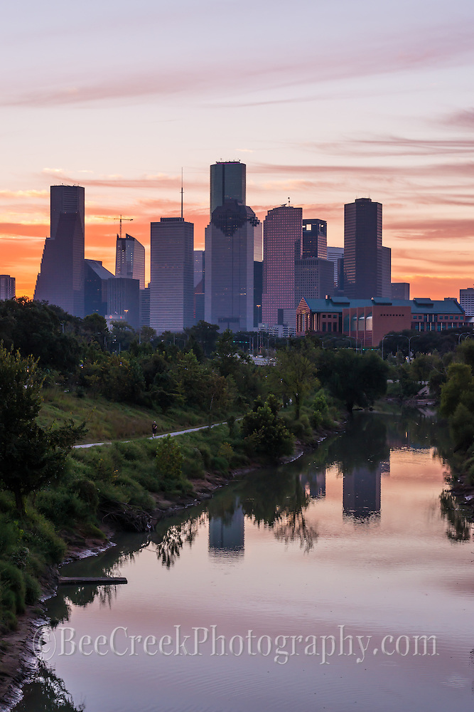 We took this verticle image at sunrise as it created this wonderful colorful backdrop for the city skyline of downtown Houston. The inage also included the bayou which picked up the colors of the sky in the water reflections along with the buildings. Watermark will not appear on image