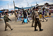 Security forces patrol the local Christmas Bazaar in Kohima, Nagaland, India. During the Second World War, Nagaland was the scene of bloody jungle warfare as the Allies sought to block a Japanese invasion of India and wrest Burma back from Tokyo's grip. The Nagas, who served as trackers and guides for the British, had hoped their loyalty would be repaid with an independent state. But when Britain granted India independence in 1947, Nagaland was simply absorbed into India. This set off a brutal insurgency against Indian rule that has lasted until today - perhaps the longest running rebellion in Asia. Over decades, the insurgents have fractured, with various Naga factions turning against one another in cycles of violence and revenge that have defied all efforts at negotiated settlement. Photograph: Sanjit Das