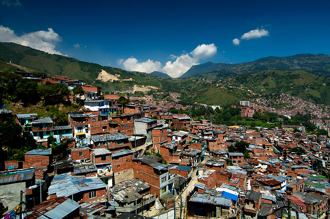 The barrio of Comuna 13 clings to the side of a steep hillside in Medellin, Colombia.  It is one of the poorest neighborhoods in Medellin.