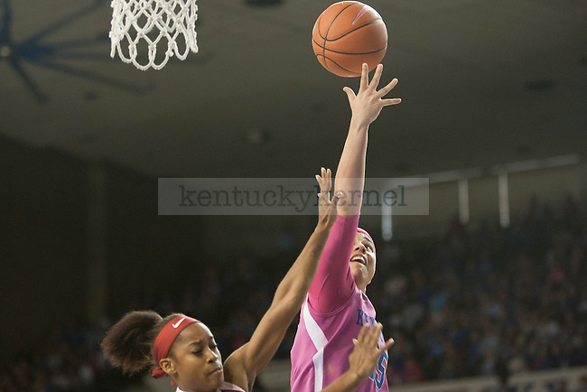 Junior guard Makayla Epps (25) shoots a layup over a defender during the game against the Arkansas Razorbacks on Sunday, February 21, 2016 in Lexington, Ky. Kentucky won the game 77-63. Photo by Hunter Mitchell | Staff
