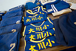 Vests and other gym clothes belonging to elementary school children from Okawa elementary school, are laid out for their owners and/or their loved ones to collect inside a school gym in Ishinomaki Prefecture, Japan on 08 Sept. 2011.  Photograph: Robert Gilhooly