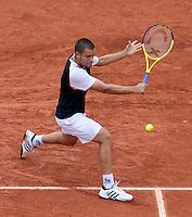Mikhail Youzhny (RUS) (11) against Tomas Berdych (CZE) (15) in the quarter finals of the men's singles. Tomas Berdych beat Mikhail Youzhny 6-3 6-1 6-2...Tennis - French Open - Day 10 - Tue 1 June 2010 - Roland Garros - Paris - France..© CameraSport-MIKE FREY - 43 Linden Ave. Countesthorpe. Leicester. England. LE8 5PG - Tel: +44 (0) 116 277 4147 - admin@camerasport.com - www.camerasport.com