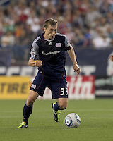 New England Revolution midfielder Zak Boggs (33) controls the ball. In a Major League Soccer (MLS) match, the New England Revolution tied New York Red Bulls, 2-2, at Gillette Stadium on August 20, 2011.