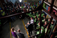 Prime Minister and Labour Party leader Gordon Brown speaks to workers at an Asda supermarket in Weymouth, watched by his wife Sarah.