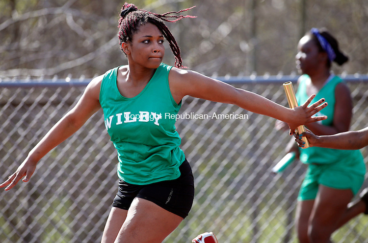 """Walcott, CT- 05 May 2015-050515CM04- Wilby's Tabitha Bolling receives the baton from Laneshia """"Speedy"""" Johnson during the girls 4x100m relay during a track meet at Wolcott on Tuesday afternoon.  Christopher Massa Republican-American"""