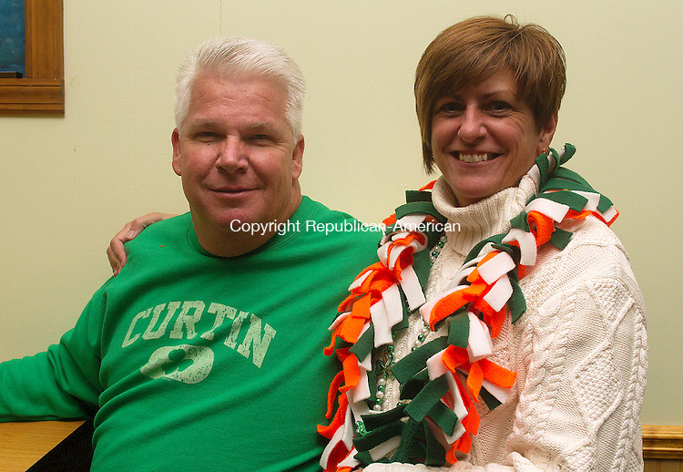 WATERBURY, CT.- 07 MARCH 2015 - 030715JW06 - Jim and Liz Curtain of Prospect pose for a photo after participating in the Annual Ancient Order of Hibernians parade Saturday afternoon.<br /> Jonathan Wilcox Republican-American
