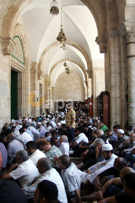 Palestinian Muslim worshippers pray inside Al-Aqsa mosque during Friday prayers in the Al Aqsa Mosque compound, also known to Jews as the Temple Mount, in Jerusalem's old city on May 28, 2010. Photo by Mahfouz Abu Turk