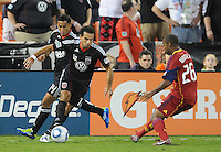 D.C. United forward Dwayne De Rosario (7)  goes against Real Salt Lake midfielder Collen Warner (26). D.C. United defeated Real Salt Lake 4-1 at RFK Stadium, Saturday September 24 , 2011.