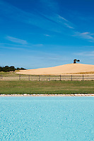The outdoor swimming pool has views over the Tuscan countryside