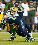 Seattle Seahawks defensive backs Richard Thomas (25) and Byron Maxwell (41) team up to tackle Green Bay Packers wide receiver Jordy nelson (87) during the third quarter of the NFL Kickoff held at CenturyLink Field September 4, 2014 in Seattle. The Seahawks beat the Packers 36-16.     ©2014  Jim Bryant Photo. ALL RIGHTS RESERVED.