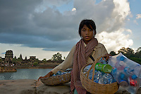 Cambodian Girl collecting plastic in front of Angkor Wat Sieam Reap, Cambodia