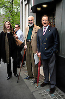 MAUD ADAMS, CHRISTOPHER LEE &amp; SIR ROGER MOORE .Having a Bond reunion lunch at The Ivy Club this afternoon, London, England..April 26th, 2010.full length blue suit jacket grey gray trousers umbrella cane beige green brown black leopard print scarf.CAP/DYL.&copy;Dylan/Capital Pictures.