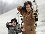 Kathy Neilsen and seven-year-old daughter Kassidy practice their  bow marksmanship at their rural home near Adel, Iowa.   Nielsen, a pheasant hunter and member of a Pheasants Forever local chapter, has gotten Kassidy and her other daughter, Kayla interested in hunting.