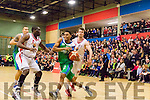 Coming through<br /> ----------------------<br /> Trae Temberton, Garvey's Tralee Warriors drives hard towards the net policed by Mike Bonaparte, watched by the capacity crowd at Tralee sports comllex last saturday night.