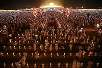 Believers leave the Wat Phra Dhammakaya temple in Pathum Thani province, north of Bangkok after a ceremony on Makha Bucha Day March 4, 2015. The Dhammakaya temple members include some of Thailand's most powerful politicians and is regarded as the country's richest Buddhist temple. Makha Bucha Day honours Buddha and his teachings, and falls on the full moon day of the third lunar month.  REUTERS/Damir Sagolj (THAILAND)