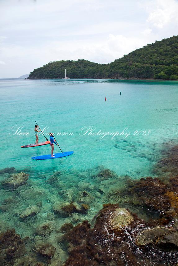 Stand up paddleboarders<br /> Hawksnest Bay / Gibney Beach<br /> Virgin Islands National Park<br /> St. John, U.S. Virgin Islands