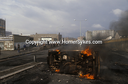 Lecky Rd Flyover, with The Bogside in the background. Derry , Londonderry. The Troubles 1980s. Burnt out hijacked car.