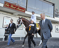 Eventual winner Gemologist, Javier Castellano up, heads to the track, under the watchful eye of trainer Todd Pletcher, for the Wood Memorial at Aqueduct Racetrack in Ozone Park, New York on Wood Memorial Day on April 7, 2012