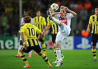 FUSSBALL   CHAMPIONS LEAGUE   SAISON 2012/2013   GRUPPENPHASE   Borussia Dortmund - Ajax Amsterdam                            18.09.2012 Mario Goetze (Borussia Dortmund) gegen Christian Poulsen (re, Ajax)