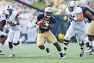 Annapolis, MD - SEPT 10, 2016: Navy Midshipmen fullback Chris High (33) breaks free for a big gain during their match up against Connecticut at Navy-Marine Corps Memorial Stadium in Annapolis, MD. Navy held on to defeat Connecticut 28-24. (Photo by Phil Peters/Media Images International)
