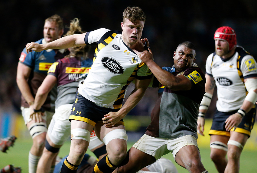 Photo: Richard Lane/Richard Lane Photography. Aviva Premiership. Harlequins v Wasps. 28/04/2017. Wasps' Will Rowlands is pulled to the ground by Quins' Kyle Sinckler.