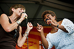 Marcia Ball sings with Irma Thomas at the New Orleans Jazz and Heritage Festival in New Orleans, Louisiana, April 30, 2011.